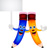 Happy pencil couple cartoon with blank sign Royalty Free Stock Photos