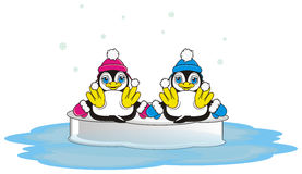 Happy penguin boy sitting with happy penguin girl on the ice Stock Photography