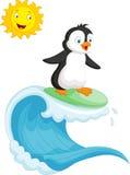 Happy penguin cartoon surfing Stock Images