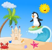 Happy penguin cartoon surfing Stock Photos