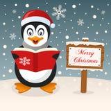 Happy Penguin & Merry Christmas Sign stock photo