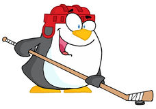 Happy penguin playing ice hockey Stock Photos