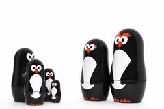 Happy penguin toy parent figure  with adorable kids. Royalty Free Stock Photography