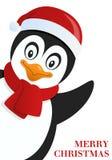Happy Penguin wishing Merry Christmas Royalty Free Stock Photo