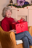 Happy pensioner Christmas gift red Royalty Free Stock Photography