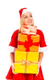 Happy pensive female Santa with Christmas gifts Royalty Free Stock Photography
