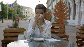Happy pensive woman drinking in a coffee shop terrace in the street stock video