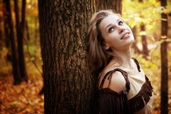 Happy pensive young woman in nature royalty free stock photos