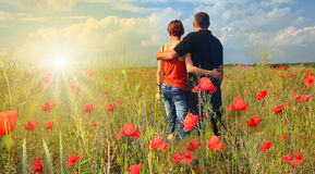 Happy people. Young couple walking in garden royalty free stock photography