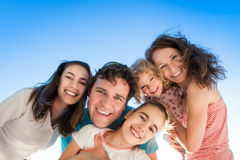 Happy people. Happy smiling people against blue sky stock photography
