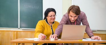 Happy people acquire knowledge. Professor and student near notebook. Happy people when finishing important task, project royalty free stock photos