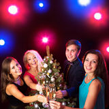 Happy people around the Christmas tree Stock Images