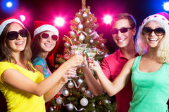 Happy people around the Christmas tree Stock Photo