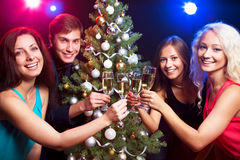 Happy people around the Christmas tree Royalty Free Stock Photo