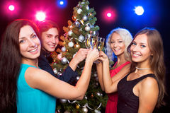 Happy people around the Christmas tree Stock Photos