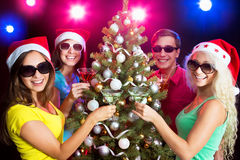 Happy people around the Christmas tree Royalty Free Stock Photography
