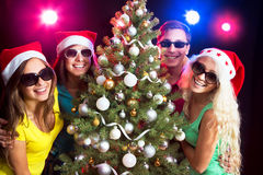 Happy people around the Christmas tree Royalty Free Stock Images