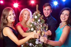 Happy people around the Christmas tree Stock Image