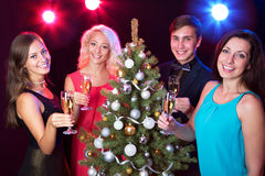 Happy people around the Christmas tree Royalty Free Stock Image