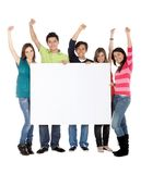 Happy people with a banner Royalty Free Stock Photography