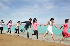 Happy people at beach Stock Images