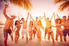 Happy people on beach Stock Image