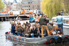 Happy people on boat at Koninginnedag 2013. Koninginnedag or Queens Day was a national holiday in the Kingdom of the Netherlands until 2013. Celebrated on 30 Royalty Free Stock Photo