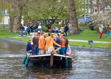 Happy people on boat at Koninginnedag 2013. Koninginnedag or Queens Day was a national holiday in the Kingdom of the Netherlands until 2013. Celebrated on 30 Stock Images