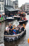 Happy people on boat at Koninginnedag 2013. Koninginnedag or Queens Day was a national holiday in the Kingdom of the Netherlands until 2013. Celebrated on 30 Stock Photo