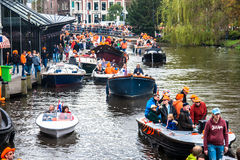 Happy people on boat at Koninginnedag 2013 Stock Photo