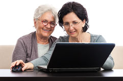 Happy people browsing internet Stock Images