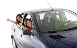 Happy people with a car Royalty Free Stock Image