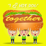 Happy people carrying a big hot dog Royalty Free Stock Images