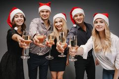 Friends celebrating Christmas drinking champagne royalty free stock photo