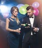 Happy people celebrating new year's eve. Couple celebrating new year's eve wth champagne Stock Images