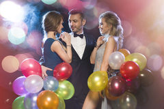 Happy people celebrating new year's eve Royalty Free Stock Images