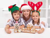 Happy people at christmas time. With gingerbread cookie house Royalty Free Stock Photography