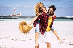 Free Happy People Couple Enjoy Relationship And Summer Holiday Vacation Together Laughing And Having Fun - Man Carry Woman And Enjoy Royalty Free Stock Images - 209652249