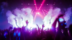 Happy People Dance in Nightclub Party Concert stock images