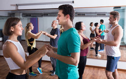 Happy  people dancing bachata together in dance class. And smiling Stock Photo