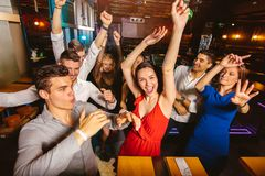 Happy people are dancing in club. Nightlife and disco concept royalty free stock images