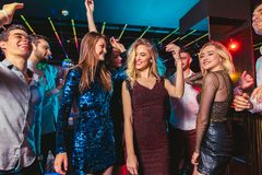Happy people are dancing in club. Nightlife and disco concept stock image