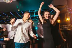 Happy people are dancing in club. Nightlife and disco concept stock images
