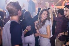 Happy people dancing at nightclub Royalty Free Stock Image