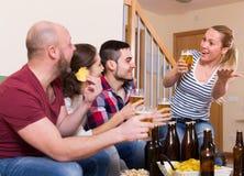 Happy people drinking beer indoor Royalty Free Stock Photo