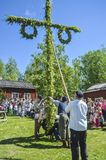 Happy people enjoying to watch pole standing moment effort by swedish people and waiting for the swedish mid summer day. Umea, Sweden - JUNE 23, 2017 Happy royalty free stock photo