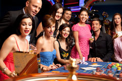 Happy people excited about roulette bet outcome Stock Photography