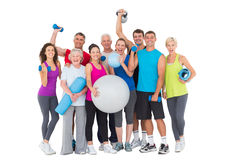 Happy people with exercise equipment Royalty Free Stock Photo
