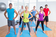 Happy people exercising in gym class Royalty Free Stock Photos