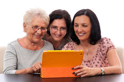 Happy people family women using tablet Royalty Free Stock Photo